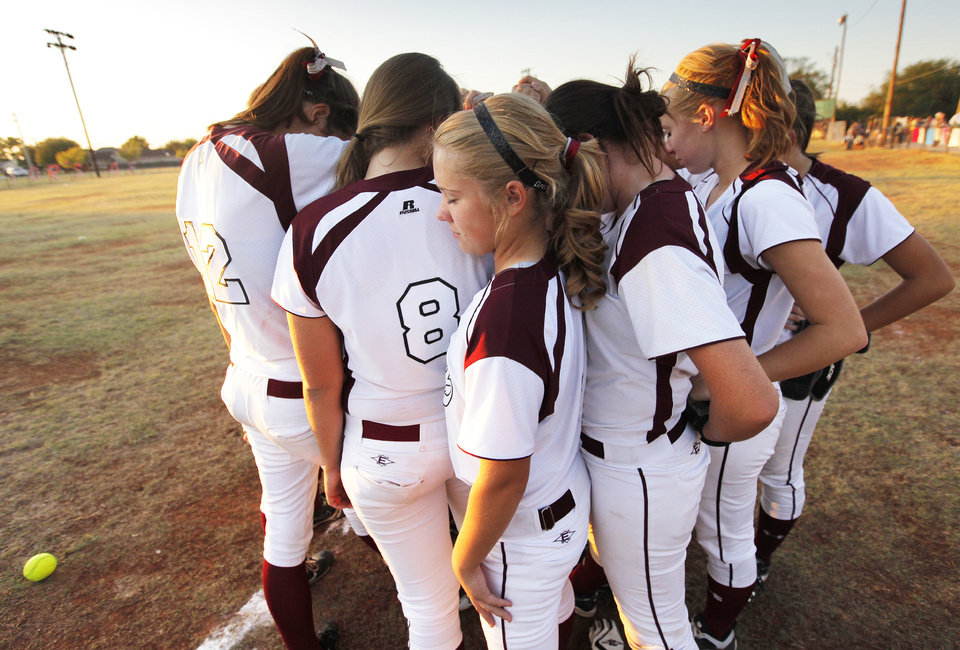 PRAYING / PRAYER: The OCA Lady Eagles, including Hannah Hayworth, middle, pray together after a high school fast pitch softball game between Oklahoma Christian Academy and Crooked Oak in Edmond, Okla., Monday, Sept. 19, 2011. Photo by Nate Billings, The Oklahoman  ORG XMIT: KOD